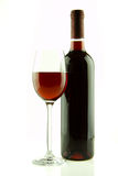 Bottle and glass of red wine isolated Royalty Free Stock Photography