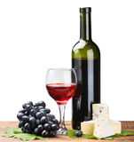 Bottle, glass of red wine and ripe grapes Royalty Free Stock Images
