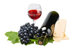 Bottle, glass of red wine and ripe grapes Royalty Free Stock Photography