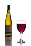 Bottle and glass of red wine on white background Royalty Free Stock Images