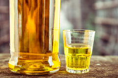 Bottle and glass shot with yellow liqour Royalty Free Stock Photos