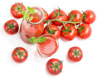 Bottle, glass of tomato juice and fruits with green leaves Royalty Free Stock Photography