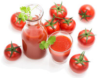 Bottle and glass of tomato juice with fruits Royalty Free Stock Photos
