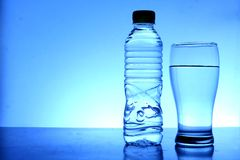 Bottle and glass of water Stock Photo