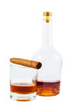 Bottle and glass of whiskey with cigar Stock Photos
