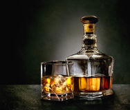 Bottle and glass of whiskey Stock Photo