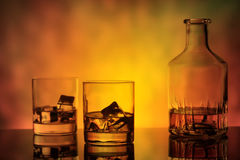 Bottle and a glass of whiskey with ice Stock Image