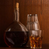 Bottle and glass with whisky Stock Photos