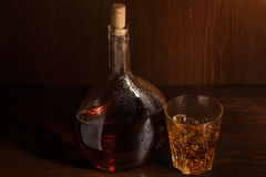Bottle and glass with whisky Stock Image