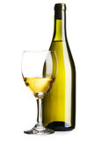 Bottle and glass of white wine Stock Image
