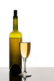 Bottle and glass of white wine Stock Images