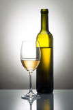 Bottle and glass of white wine Royalty Free Stock Image