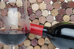 Bottle and glass of wine on a background of corks Royalty Free Stock Photography