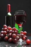 Bottle and glass of  wine on black background Stock Photos