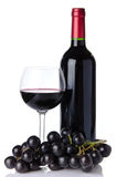Bottle and glass of wine with black grapes Royalty Free Stock Photo