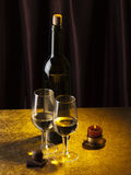 Bottle, glass with wine and candle Stock Photo