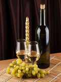 Bottle, glass with wine and candle Stock Photos