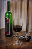 bottle, glass of wine and corkscrew stock photo