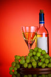 Bottle and glass of wine, grape bunch Royalty Free Stock Image