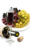 Bottle,  glass of wine and a plate with grapes Royalty Free Stock Images