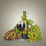 Bottle, glass of wine and ripe grapes Royalty Free Stock Image