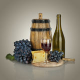 Bottle, glass of wine,  ripe grapes and cheese Royalty Free Stock Photography