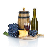 Bottle, glass of wine, ripe grapes and cheese isolated on white