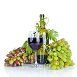 Bottle, glass of wine and ripe grapes isolated on white Stock Photos