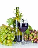 Bottle, glass of wine and ripe grapes isolated on white Royalty Free Stock Photos
