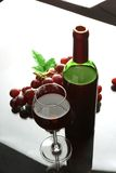 Bottle and glass of  wine on white background Stock Images