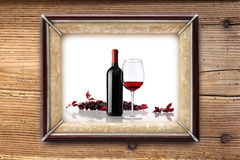 Bottle and glass of wine on wooden backgrounds Stock Photography