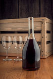 Bottle and a glass of wine on a wooden backgroung Royalty Free Stock Photo