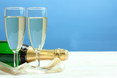 Bottle and glasses of champagne Stock Images