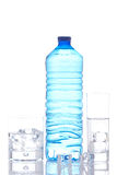 Bottle and glasses of mineral water with ice cubes Stock Photo
