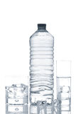 Bottle and glasses of mineral water with ice cubes Royalty Free Stock Photo