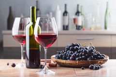 Bottle and glasses of red wine . Royalty Free Stock Image