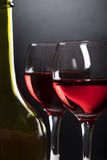 Bottle, glasses with red wine  on black gradient Stock Images