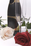 Bottle, glasses and roses Royalty Free Stock Photos