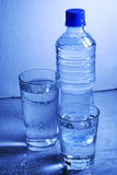 Bottle and glasses of  water Royalty Free Stock Photo