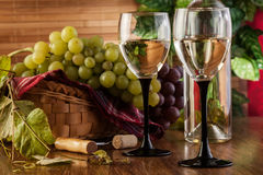 Bottle and glasses of white wine Stock Images