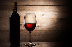 Bottle and gloss of wine Royalty Free Stock Photo