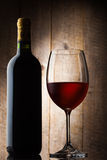 Bottle and gloss of wine Royalty Free Stock Photography