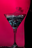 Bottle and goblet on pink Stock Photography