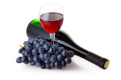 Bottle and goblet of red wine with grapes Stock Photos