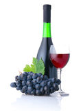 Bottle and goblet of red wine with grapes isolated Royalty Free Stock Images