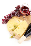 Bottle of great wine with wineglass and cheese Royalty Free Stock Photos