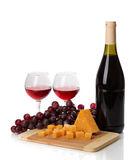 Bottle of great wine with wineglasses and cheese Royalty Free Stock Photos