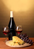 Bottle of great wine with wineglasses and cheese Royalty Free Stock Images