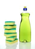 Bottle of green dishwashing liquid and sponges. On white background Royalty Free Stock Photos