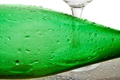 Bottle from green glass. And wineglass  on white Royalty Free Stock Photos